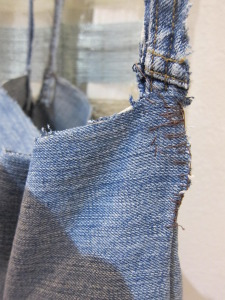 sewing the hanging strap on a denim planter