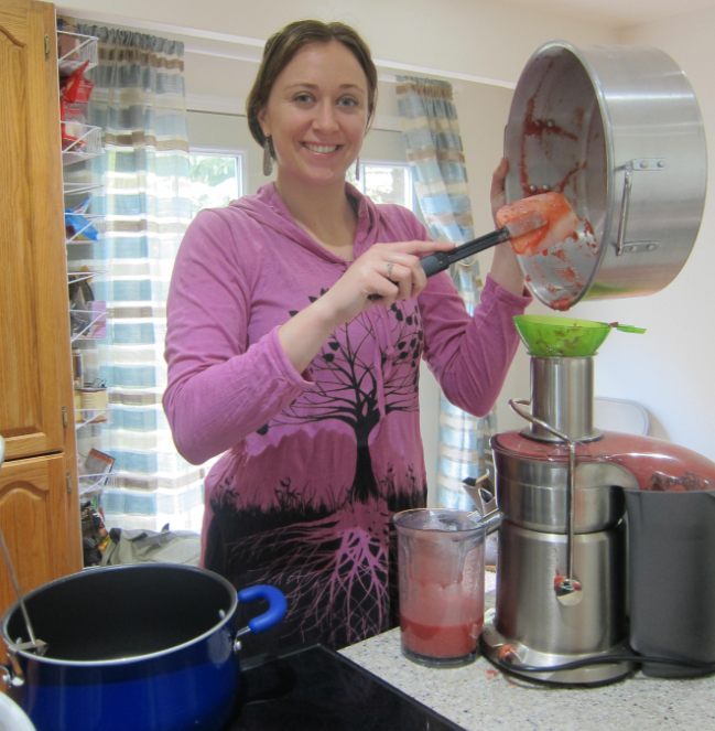 Ashley Taborsky putting crabapple blend through juicer