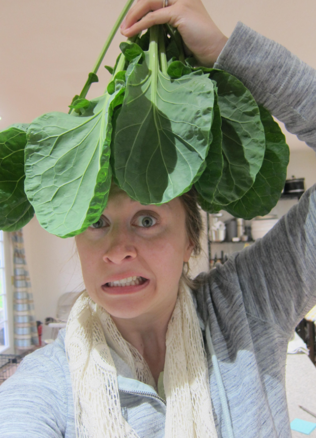 brussels sprout leafy greens on woman's head