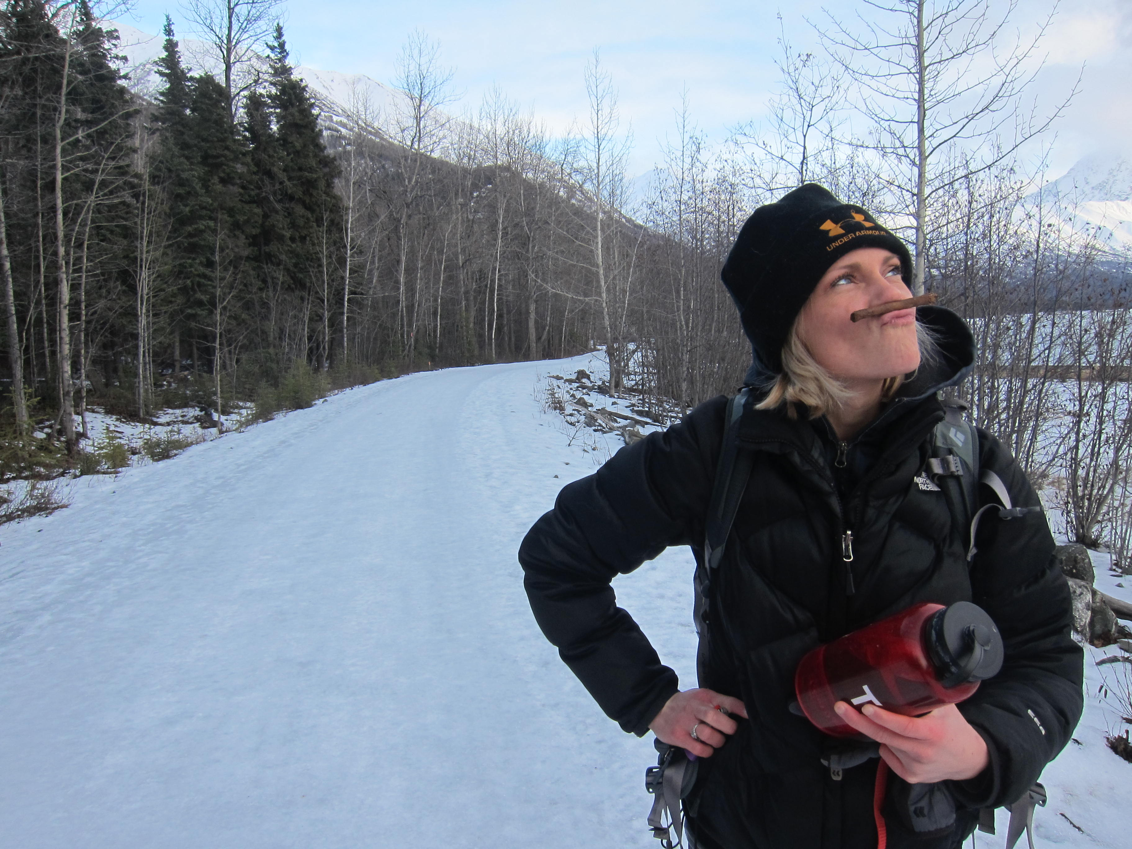 woman with cigar on winter trail
