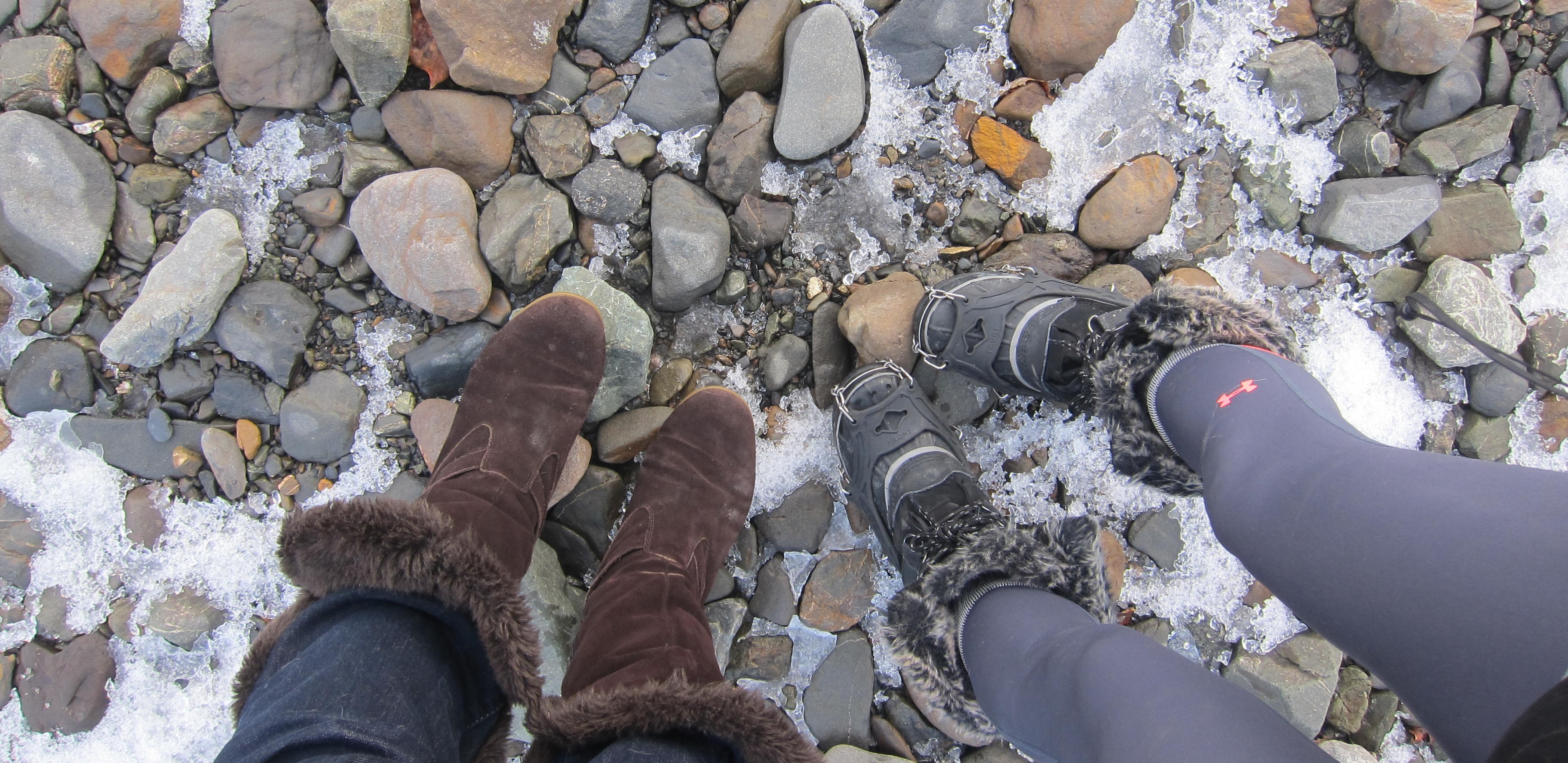 women's boots standing on rocks