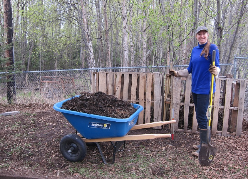 Ashley Taborsky next to compost pile