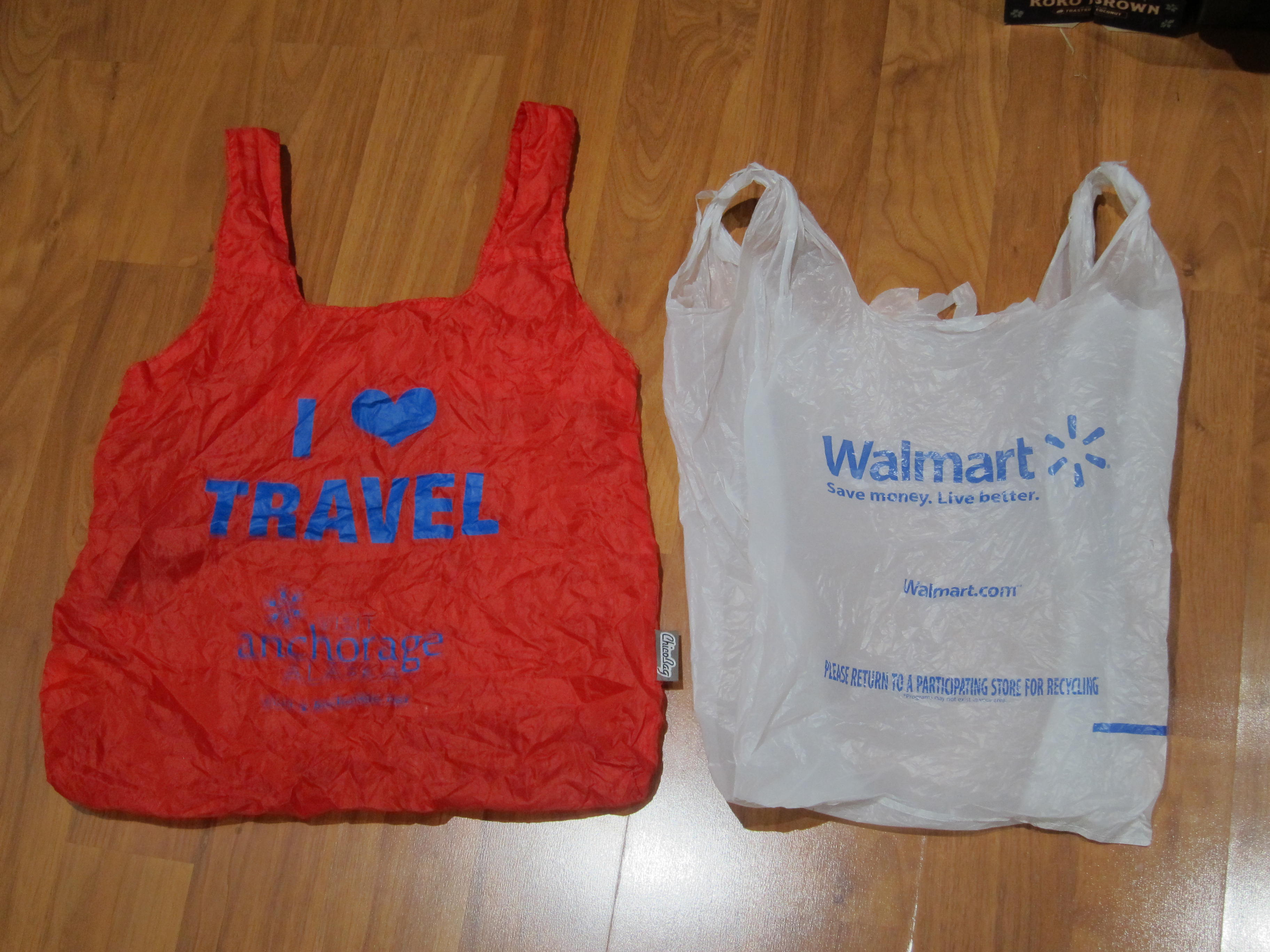 reusable bag next to a Walmart bag