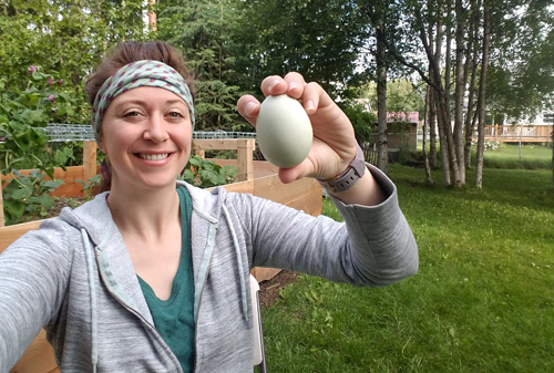 Ashley Taborsky holding green chicken egg