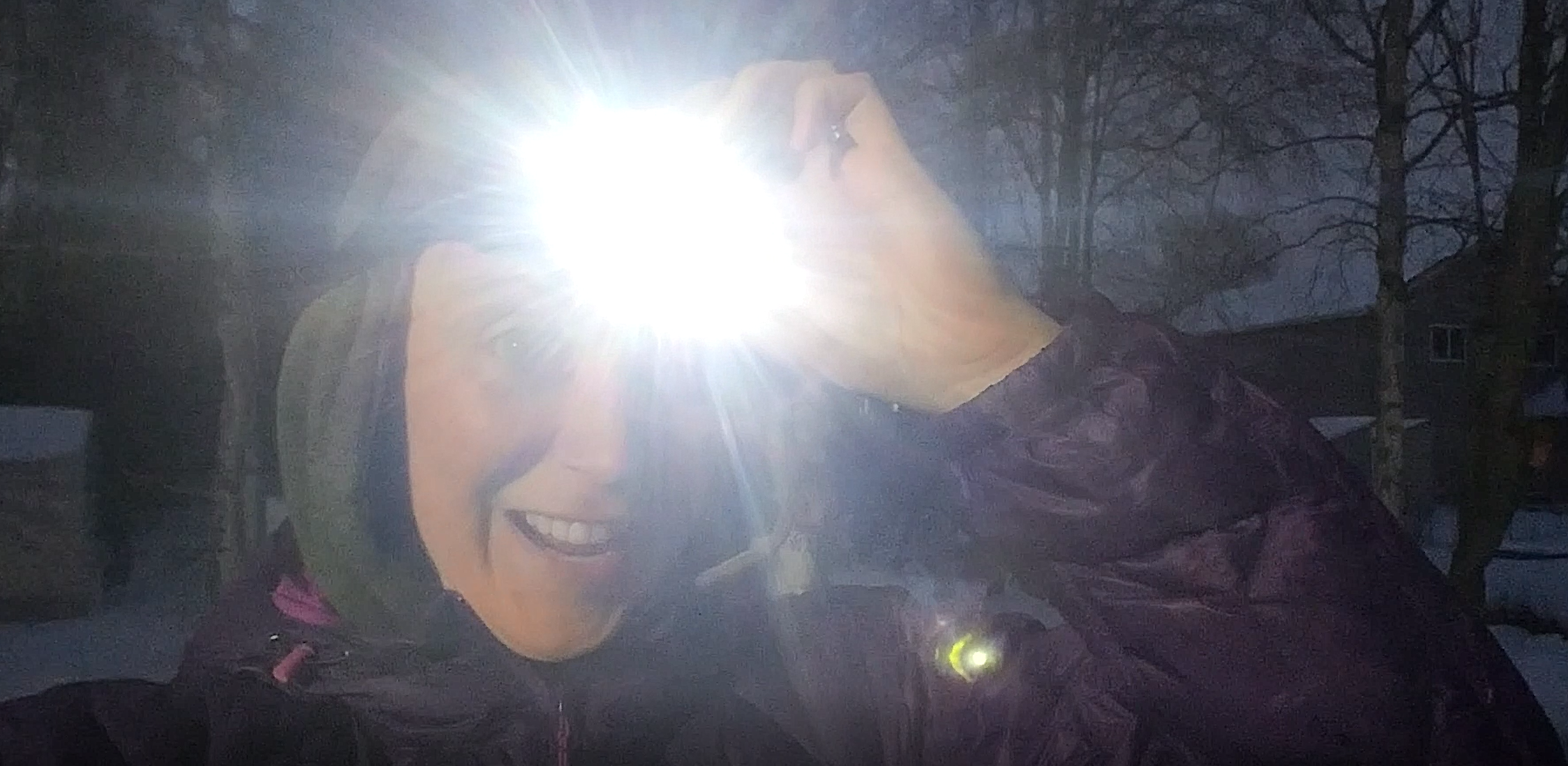 Ashley Taborsky with headlamp in winter